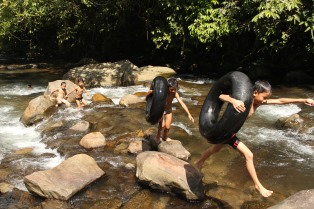 Children gleefully takes tyres as floating device during their swim