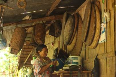 Woman surrounded with traditional bamboo-woven items